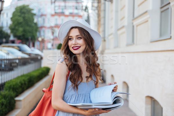 женщину Hat чтение журналы улице Сток-фото © deandrobot