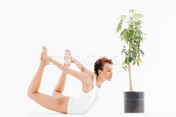 Csinos afroamerikai fiatal nő testmozgás gyakorol jóga Stock fotó © deandrobot