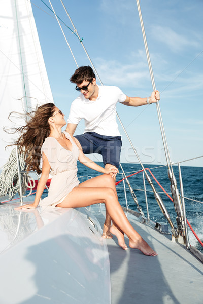 Young beautiful married couple relaxing on the yacht Stock photo © deandrobot