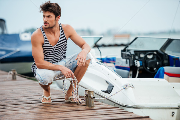 Homme bateau commencer pier jeunes bel homme Photo stock © deandrobot