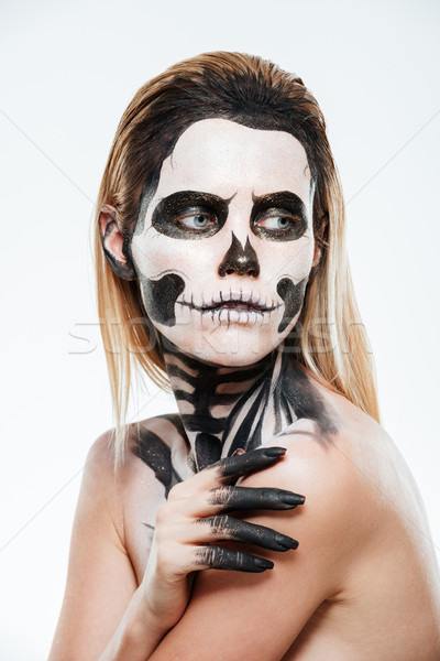 Portrait of young woman with gothic halloween makeup Stock photo © deandrobot