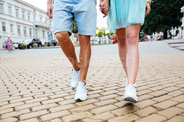 Cropped image of a couple walking holding hands on street Stock photo © deandrobot