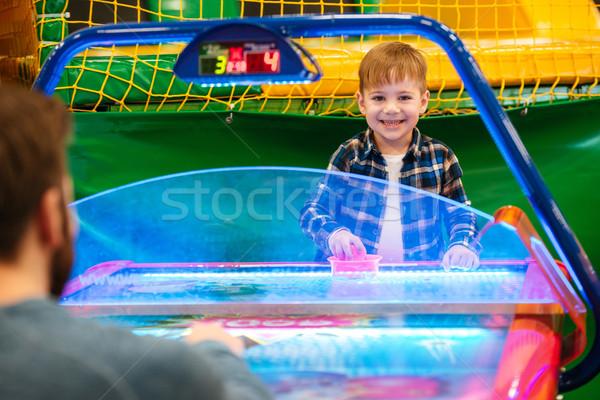 Sorridente bonitinho pequeno menino jogar ar Foto stock © deandrobot