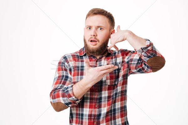 Surpreendido barbudo homem camisas telefone Foto stock © deandrobot