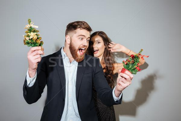 привлекательный радостный пару Smart носить Рождества Сток-фото © deandrobot