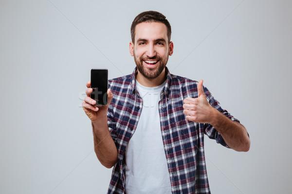 Barbudo homem tela polegar Foto stock © deandrobot