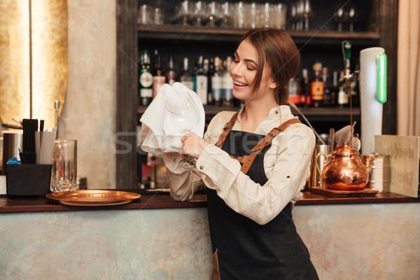 Boldog fiatal nő áll kávézó törlés üveg Stock fotó © deandrobot