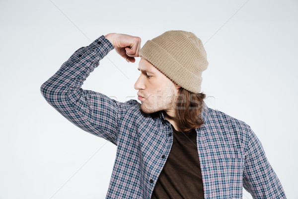 Stock photo: Serious hipster showing bicep