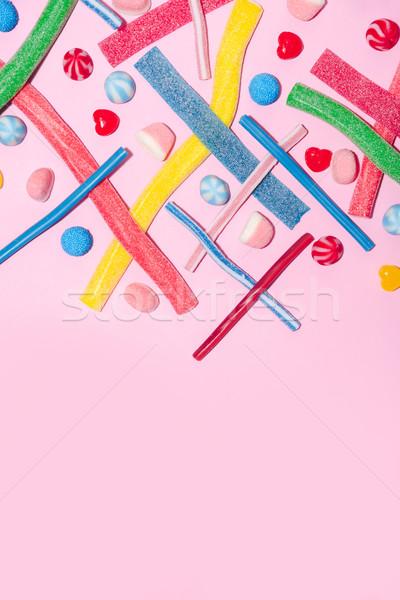 Felső kilátás vegyes színes cukorkák izolált Stock fotó © deandrobot