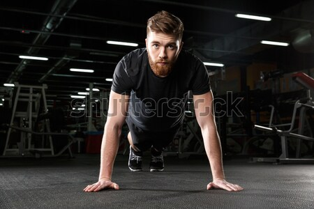 Strong sports lady make sport exercises Stock photo © deandrobot