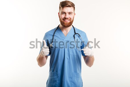 Retrato sonriendo doctor de sexo masculino pie armas doblado Foto stock © deandrobot