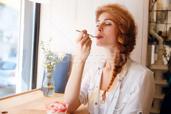 привлекательный счастливым сидят наслаждаться еды Сток-фото © deandrobot