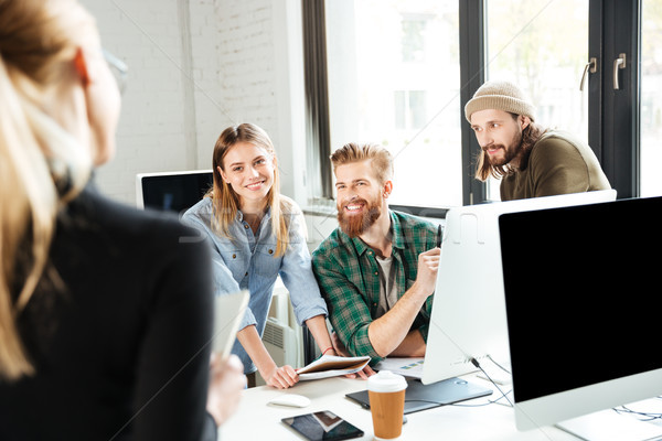 Stock photo: Happy colleagues in office talking with each other