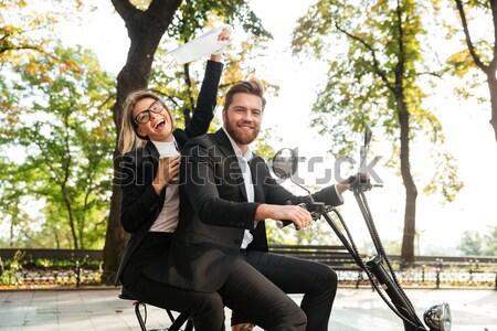 вид сбоку счастливым деловой женщины сидят современных мотоцикле Сток-фото © deandrobot