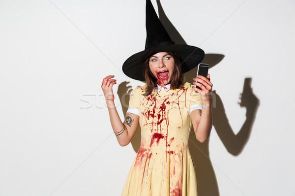Przerażający kobieta halloween kostium smartphone Zdjęcia stock © deandrobot