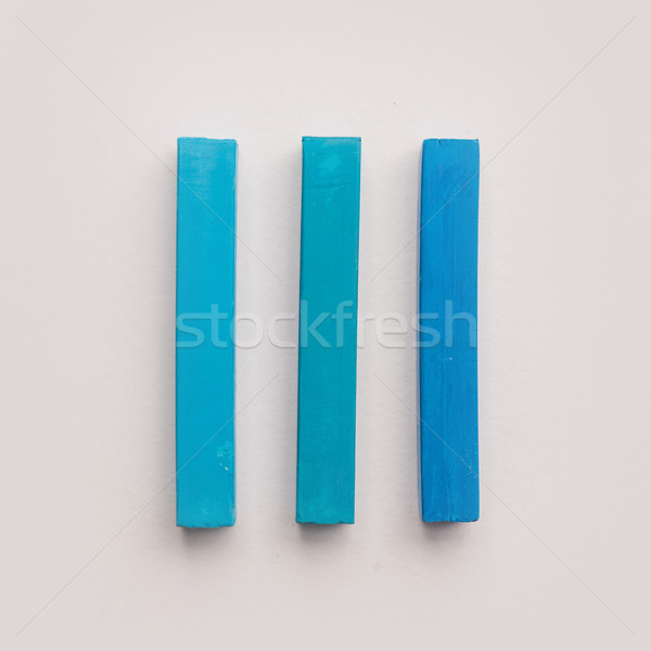 Three pieces of blue pastel crayon chalks Stock photo © deandrobot