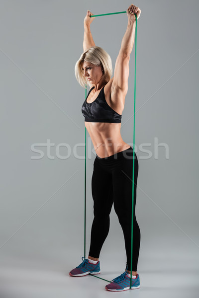 Stock photo: Side view photo of healthy sports woman with raised arms stretch