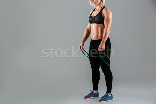 Cropped image of a fit muscular adult sportswoman Stock photo © deandrobot