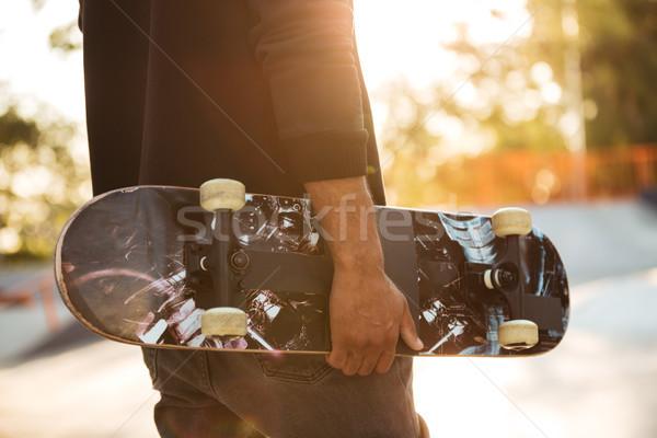 Close up of an african man skateboarder Stock photo © deandrobot
