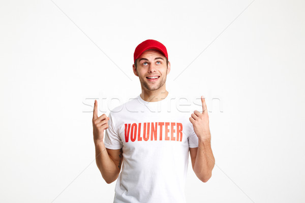 Portrait of a young man wearing volunteer t-shirt Stock photo © deandrobot
