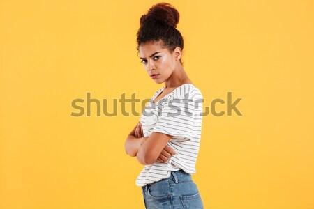 Portrait of a beautiful brunette woman dressed in denim jacket Stock photo © deandrobot