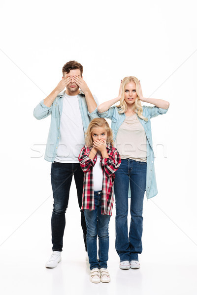 Full length portrait of young family Stock photo © deandrobot