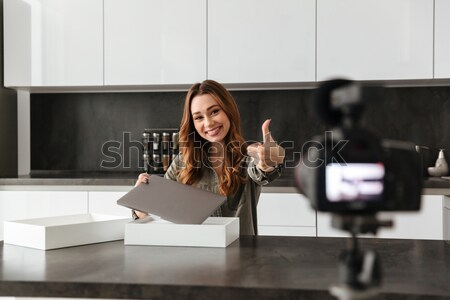 Happy young girl recording video blog episode Stock photo © deandrobot
