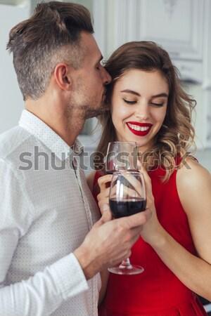 Portrait of a smiling romantic smart dressed couple Stock photo © deandrobot