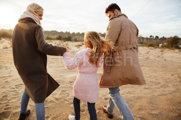 Portrait of a cheery family with a little daughter Stock photo © deandrobot