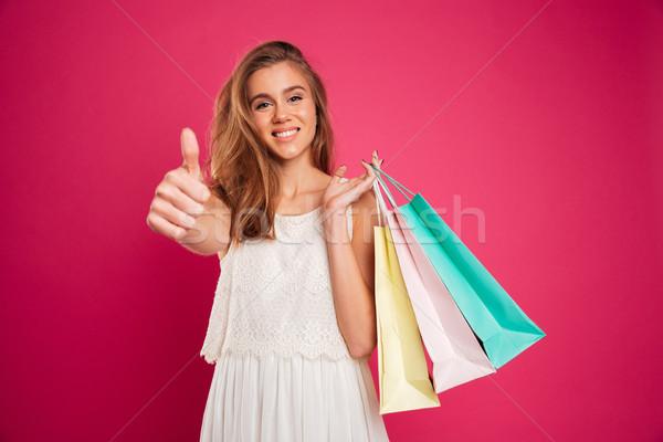 Portré boldog mosolyog lány tart bevásárlótáskák Stock fotó © deandrobot