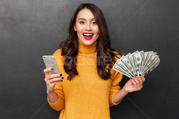 Stock fotó: Boldog · barna · hajú · nő · pulóver · tart · pénz