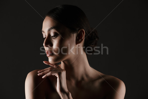 Portrait of sensual beautiful woman looking aside while touching Stock photo © deandrobot