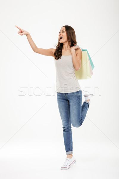Portret modieus vrouw wijzend vinger weg Stockfoto © deandrobot
