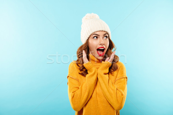 Portrait of an excited young girl dressed in winter clothes Stock photo © deandrobot