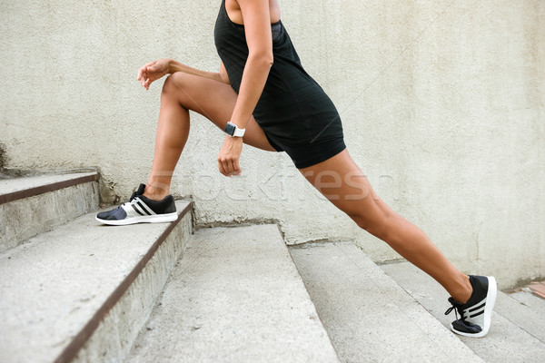 Crossed image of a fitness woman doing stretching exercises Stock photo © deandrobot