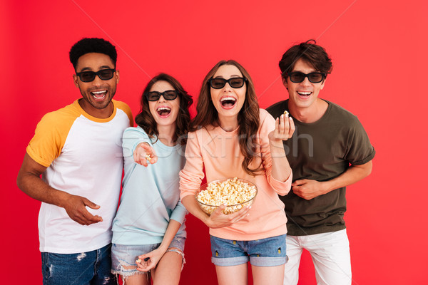 Portrait of a cheerful young group of multiracial friends Stock photo © deandrobot