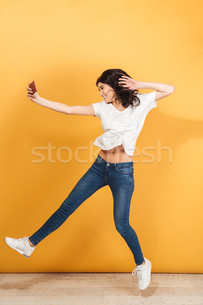 Emotional woman make selfie by mobile phone. Stock photo © deandrobot