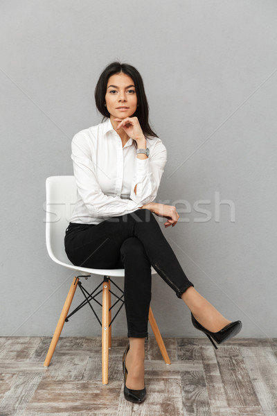 Full length image of elegant businesswoman 30s in formal wear si Stock photo © deandrobot