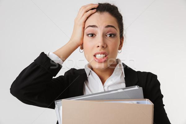 Giovani confusi donna d'affari cartelle immagine Foto d'archivio © deandrobot