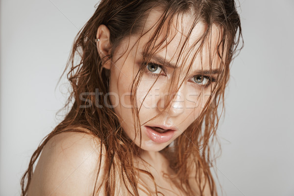 Close up fashion portrait of a topless seductive woman Stock photo © deandrobot