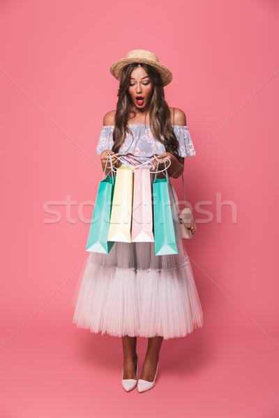 Full length portrait of shopaholic shopaholic woman 20s wearing  Stock photo © deandrobot