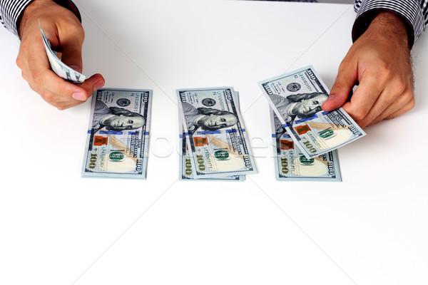 Zakenman honderd bureau geld hand Stockfoto © deandrobot