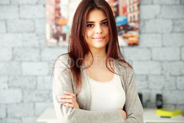 молодые счастливым деловая женщина оружия сложенный Постоянный Сток-фото © deandrobot