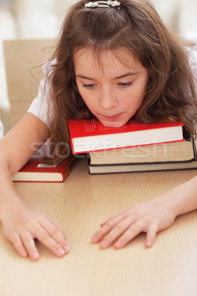 Zmęczony uczennica podbródek książek uśmiech książki Zdjęcia stock © deandrobot
