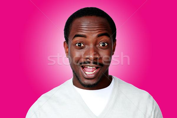 Portret zdziwiony Afryki człowiek różowy czarny Zdjęcia stock © deandrobot
