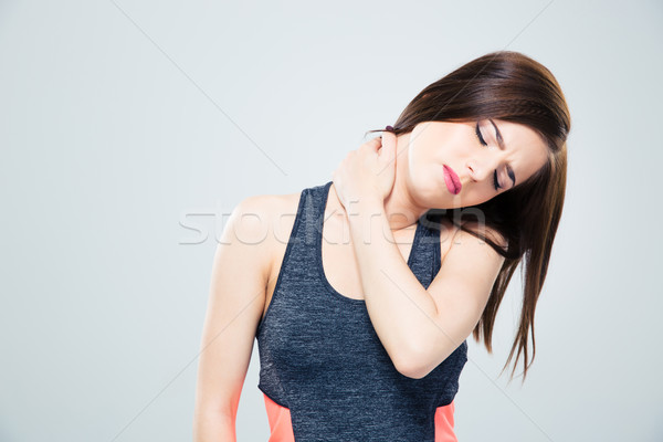 Fitness young woman with neck pain Stock photo © deandrobot