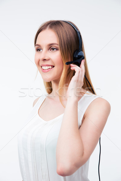 Happy young female operator in headset Stock photo © deandrobot