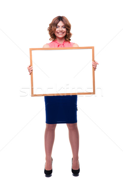 Happy casual woman holding whiteboard Stock photo © deandrobot