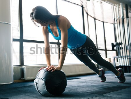 Young woman doing push up  Stock photo © deandrobot