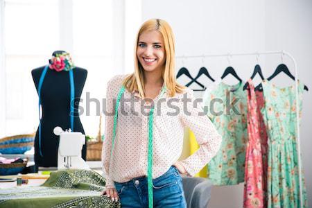 Női szabó notebook ceruza műhely mosolyog Stock fotó © deandrobot